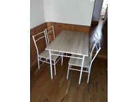 Dining table with 4 chairs hardly used