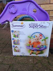 SUMMER deluxe activity seat. Like new. Boxed