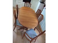 Teak Oval Pedestal Extending Dining Table with Six Chairs