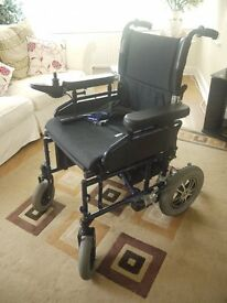 Outdoor brand new power wheelchair. Used twice. 6 months old.