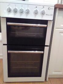 Milano freestanding oven with electric hob. 1 year old. Excellent condition