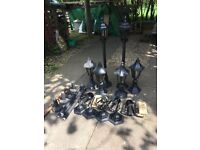 Outdoor lamps, 4 post lamps and 6 pedestal lamps, unused.