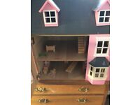 Dolls house with a selection of dolls furniture