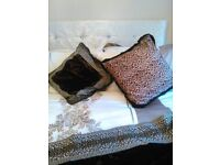 4 Cushion covers, measures: attractive velour black with animal print border and animal print