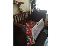 Excellent condition cot/cotbed with a storage draw