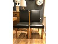 2x faux leather chairs - Black