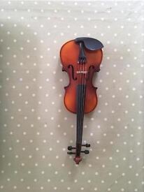 Child's 1/2 size violin and case.
