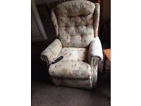 Electric rise/recliner arm chair with reading light in tapestry material.