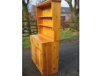 Pine welsh dresser with detachable top.