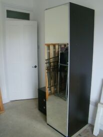 Modern black mirrored wardrobe and set of drawers