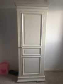 Tall white cupboard