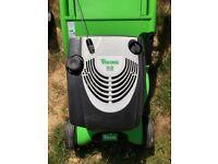Green petrol lawnmower