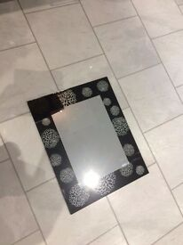 Modern rectangular mirror designed with black edging