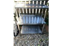 Stainless steel bench c/w microwave shelve