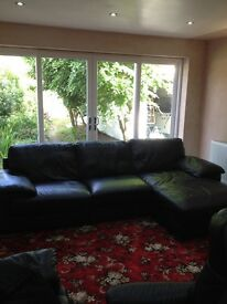 Black leather sofa and reclining chair