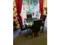 Chrome and glass table with 4 chairs