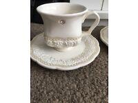 Cream diamonte tea cups and saucers