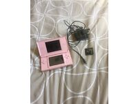 Pink Nintendo ds memory card with games and charger