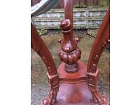 large carved wooden plant stand