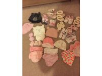 Bundle of hats, gloves, scratch mitts, head bands, socks, bibs, baby knickers, and shoes
