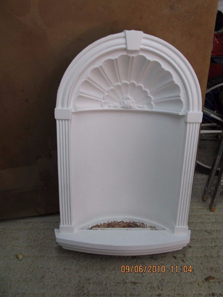 plaster niche with light and glass shelve,