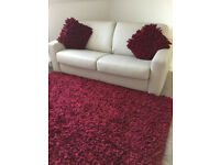 Luxurious large plush red rug with 2 matching cushions from Furniture Village, good as new