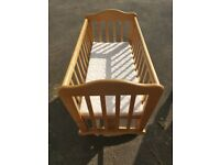 Lovely wooden rocking cot. Beautifully made, with mattress