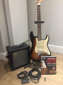 Electric guitar starter set. Squier Fender Strat, with amp, stand, tuner & book £180 ono