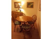 Round pine kitchen or dining table and 4 chairs