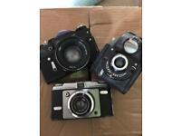 3 vintage cameras