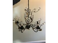 Beautiful 5 light chandelier with black and gold leaf detail