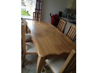 Solid oak dining table & 6 matching chairs