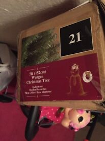 Great condition used once five foot xmas tree with stand and lights