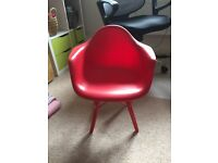 Bright red Charles Eames Style plastic retro chair