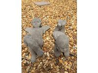 Various concrete garden ornaments all ne