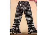 Navy Polka Dot Flare Hem Trousers. Available in size 8 & 10.