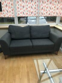 Three seater grey sofa
