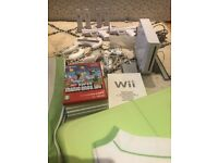 Wii with 4 remotes, balance board, and 6 games