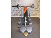 V-Fit-St bench with leg curler and extender and 117.3kg of weights,like new, perfect for first timer