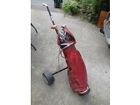 Golfing bag, trolley and set of Slazenger clubs, ideal second set/beginners