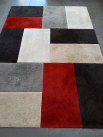 Good quality geometric rug - predominately red