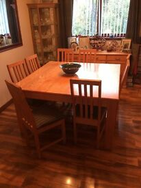 Large solid light oak diningroom table , 8 chairs and a sideboard for sale