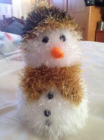 Hand knitted snowmen