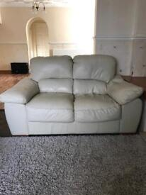 Cream leather 2 seater sette and 1 chair