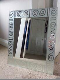 Spiral decorated mirror