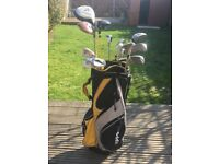Hippo Golf Bag with assorted clubs and balls