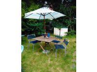 garden table, 4 chairs and umbrella for sale
