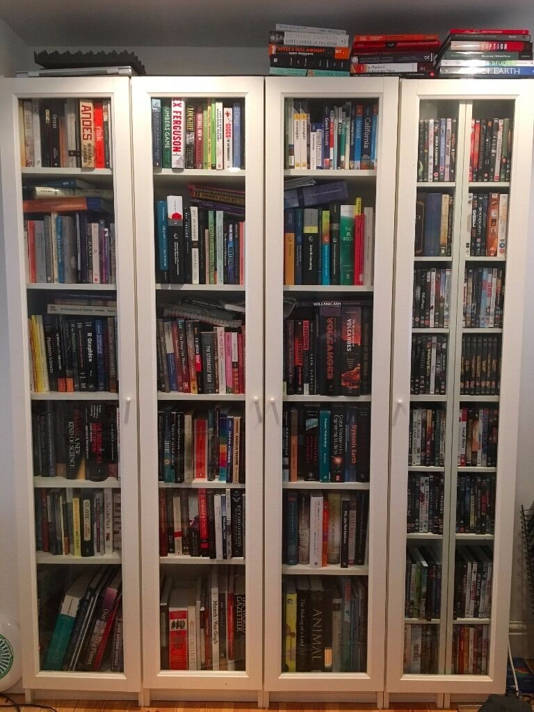set of four white ikea billy bookcases with glass doors. Black Bedroom Furniture Sets. Home Design Ideas