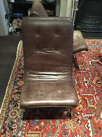 A pair of Italian chairs. Cast iron frames, leather upholstery