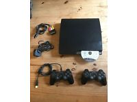 Sony PS3, 2 Controllers & 8 Games